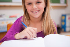 Close up of a young schoolgirl writing Royalty Free Stock Photography