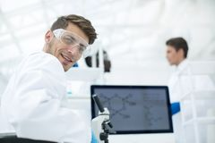 Close up.a young scientist in a modern laboratory. Science and information technology Stock Image
