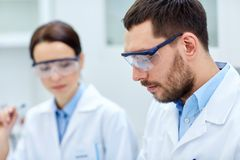 Close up of young scientists at laboratory Stock Images
