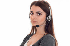 Close up of young serious call center woman woman with headphones and microphone isolated on white background Royalty Free Stock Photos