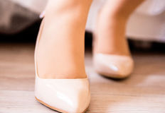 Close up of a young sophisticated woman trying on new shoes. Photo of Close up of a young sophisticated woman trying on new shoes Stock Photos