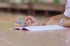 Close up of young student hands writing on notebook Royalty Free Stock Photos