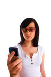 Close up of young woman. Texting on mobile phone Stock Images