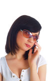 Close up of young woman. Talking on mobile phone Royalty Free Stock Photos