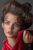 Close-up of young woman with art make-up Royalty Free Stock Image