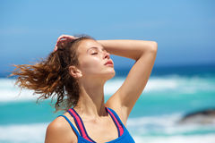 Close up young woman at the beach with hand in hair Royalty Free Stock Images