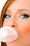 Close up of young woman blowing chewing gum Royalty Free Stock Photography