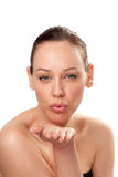 Close up of a young woman blowing a kiss Royalty Free Stock Image