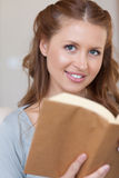 Close up of young woman with a book Royalty Free Stock Images