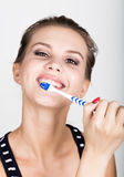Close-up of a young woman is brushing her teeth. Dental health care concept. Stock Photo