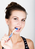 Close-up of a young woman is brushing her teeth. Dental health care concept. Royalty Free Stock Photography