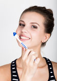 Close-up of a young woman is brushing her teeth. Dental health care concept. Royalty Free Stock Image
