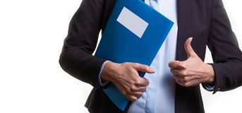 Close up of a young woman in a business suit holding a file. Copy space royalty free stock image
