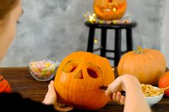 Halloween themed image with carved pumpkins in house party environment. stock images