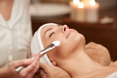 Close up of young woman and cosmetologist in spa Royalty Free Stock Image
