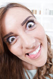 Close up of young woman with crazy and mad face expression stock photography