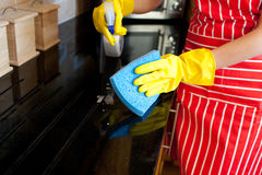 Close-up of a young woman doing housework Royalty Free Stock Images