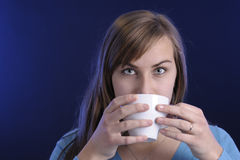 Close-up of young woman drinking coffee Stock Image
