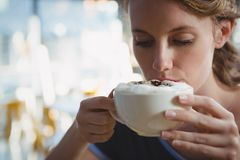 Close-up of woman drinking coffee royalty free stock photo