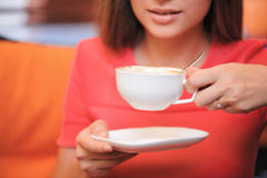 Close-up of young woman drinking coffee Royalty Free Stock Photography