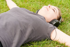 Close-up of young woman enjoying music during recreation time Stock Photography