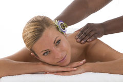 Close up of Young woman enjoying spa treatment. Therapist doing Stock Photography