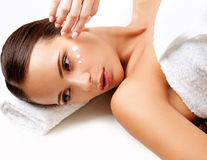 Close-up of a Young Woman Getting Spa Treatment. Cosmetic Cream. On a Cheek. Skin Care Royalty Free Stock Photos