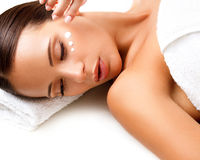 Close-up of a Young Woman Getting Spa Treatment. Cosmetic Cream Stock Photo