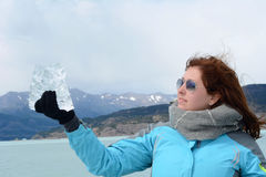 Close up of young woman at glacier in the Patagonia Argentina. Royalty Free Stock Photos