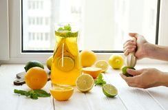 Summer healthy non alcoholic cocktails, citrus infused water drinks, lemonades with lime lemon or orange, diet detox beverages. royalty free stock image