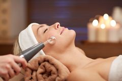 Close up of young woman having face massage in spa Royalty Free Stock Photo