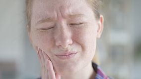 Close up of young woman having tooth ache stock video