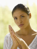 Close-up of a young woman with her hands clasped Stock Photography