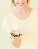 Close-Up Of Young Woman Holding Butterfly In Palm Royalty Free Stock Photos