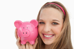 Close-up of a young woman holding a piggy-bank Royalty Free Stock Image