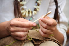 Close up of young woman knitting with bone needles Royalty Free Stock Photos