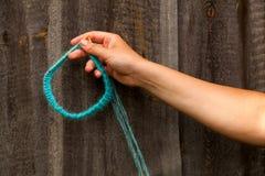 Close-up Young woman knitting stock photos