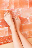 Close-up of young woman legs on salty wall Royalty Free Stock Images