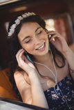 Close up of young woman listening music royalty free stock image