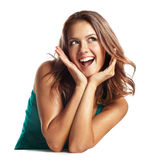 Close-up of a young woman looking surprised on white background Stock Photos