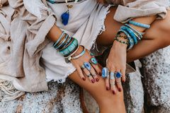 Close up of young woman with lot of boho accessories outdoors. Close up of young woman with lot of boho accessories royalty free stock photos