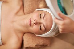 Close up of young woman lying in spa Stock Image