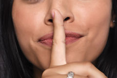Close up of young woman making silence gesture. Royalty Free Stock Photos
