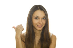 Close-up of a young woman pointing Stock Photography