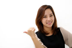Close-up of a young woman pointing Royalty Free Stock Photo
