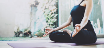 Close up of young woman practicing yoga in a training hall. Freedom concept. Calmness and relax, female happiness royalty free stock image