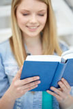 Close up of young woman reading book at school Stock Image