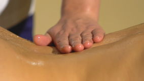 Close-up of young woman receiving back massage stock video footage