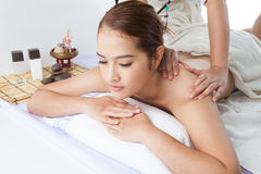 Close-up of a young woman receiving back massage at spa Stock Photography
