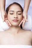 Close-up of young woman receiving facial massage at day spa Royalty Free Stock Photos